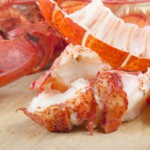 lobster meat and shell on wooden board