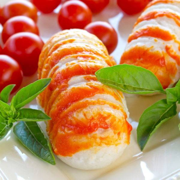 plate of surimi lobster, tomatoes and basil